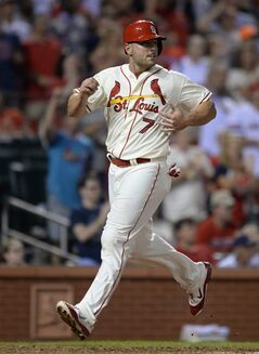 St. Louis Cardinals' Matt Holliday scores on an RBI triple by Matt Adams against the San Diego Padres in the fifth inning in a baseball game, Saturday, Aug, 16, 2014, at Busch Stadium in St. Louis. (AP Photo/Bill Boyce)