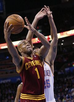 Cleveland Cavaliers guard Jarrett Jack (1) shoots in front of Oklahoma City Thunder guard Thabo Sefolosha (25) during the first quarter of an NBA basketball game in Oklahoma City, Wednesday, Feb. 26, 2014. (AP Photo/Sue Ogrocki)