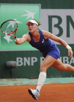 The bandage on the left shin of Australia's Samantha Stosur is seen as she returns the ball during the first round match of the French Open tennis tournament at the Roland Garros stadium, in Paris, France, Monday, May 26, 2014. Stosur sustained an injury last week when working out in the gym. (AP Photo/David Vincent)