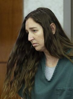 Megan Huntsman, who is accused of killing six of her babies and storing their bodies in her garage, appears in court, Monday, April 28, 2014, in Provo, Utah. Prosecutors filed six first-degree murder charges against Huntsman, Monday shortly before Huntsman appeared in court for the second time. (AP Photo/Rick Bowmer, Pool)