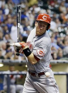 Cincinnati Reds' Todd Frazier is hit by a pitch during the fourth inning of a baseball game against the Milwaukee Brewers, Tuesday, July 22, 2014, in Milwaukee. (AP Photo/Morry Gash)