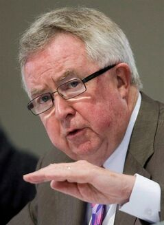Former prime minister Joe Clark answers a question at a panel discussion in Ottawa, Monday June 22, 2009. Clark says he can't understand why the Harper government would bar the opposition from a delegation to Ukraine and suggests its combative approach to international issues sometimes hurts the country.THE CANADIAN PRESS/Sean Kilpatrick