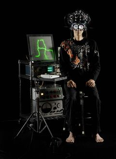 Japanese acupuncturist/musician Masaki Batoh hooked up to his Brain Pulse Music machine.