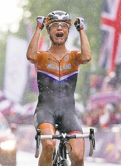 Frank Gunn / The Canadian Press Marianne Vos celebrates after winning gold in the women's road race.