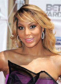 FILE - This July 1, 2012 file photo shows Tamar Braxton at the BET Awards in Los Angeles. Braxton is nominated for three honors at Sunday's Grammy Awards, including best urban contemporary album for her first album in 13 years,