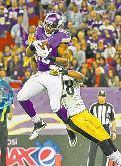 Vikings wide receiver Greg Jennings grabs a touchdown pass despite the challenge of Steelers cornerback Cortez Allen during their game at Wembley Stadium in London on Sunday.