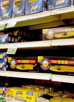 In this May 9, 2014 photo, Dreamfields Pasta is seen on the shelves of a grocery store in Farno, N.D. A company accused of falsely advertising the health benefits of its nationally distributed Dreamfields Pasta has agreed to pay $5 million to consumers as part of a class-action settlement. The complaint accuses Carrington, North Dakota-based Dakota Growers Pasta and its parent company of bogus claims that the product was a low-carbohydrate alternative to traditional pasta. (AP Photo/Bruce Crummy)