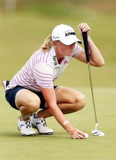 Stacy Lewis of the US lines her putt on the 9th green, during the third day of the Women's British Open golf championship, at the Royal Birkdale Golf Club, in Southport, England, Saturday, July 12, 2014. (AP Photo/Scott Heppell)