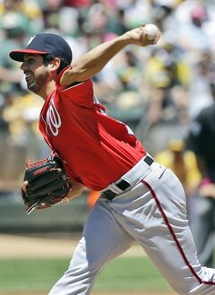 Washington Nationals starting pitcher Gio Gonzalez throws to the Oakland Athletics during the first inning of a baseball game on Sunday, May 11, 2014, in Oakland, Calif. (AP Photo/Marcio Jose Sanchez)