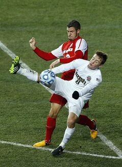 Notre Dame's Nick Besler (8) keeps the ball from New Mexico's Kyle Venter (12) in the second half during a semifinal match in the NCAA Division 1 men's soccer championships in Chester, Pa., Friday, Dec. 13, 2013. Notre Dame defeated New Mexico 2-0 to advance to Sunday's championship game. (AP Photo/Rich Schultz)