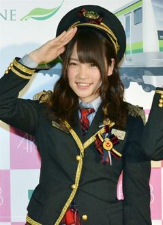 In this Jan. 29, 2014 photo, Rina Kawaei of AKB48 poses in a promotion event in Yokohama, near Tokyo. Kawaei and Anna Iriyama, members of the all-female Japanese pop group AKB48 and one staffer have been injured by a saw-wielding man at a fan event. Japanese media reports and a statement on the group's official blog say that 18-year-old Iriyama and 19-year-old Kawaei were cut on their hands and head. (AP Photo/Kyodo News) JAPAN OUT, MANDATORY CREDIT