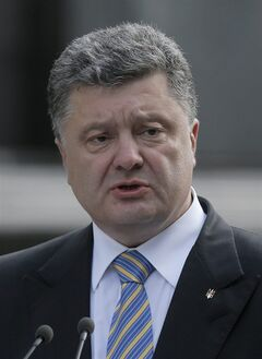 In this photo taken on Saturday, Aug. 23, 2014, Ukraine's President Petro Poroshenko makes a statement to the press in Kiev, Ukraine. Poroshenko on Monday, Aug. 25, dissolved parliament and called for early elections in October 26 as his country continues to battle a pro-Russian insurgency in its eastern regions. (AP Photo/Efrem Lukatsky)