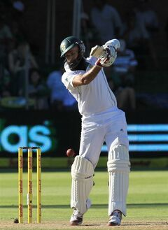 South Africa's batsman Hashim Amla, plays a shot on the third day of their 2nd cricket test match against Australia at St George's Park in Port Elizabeth, South Africa, Saturday, Feb. 22, 2014. (AP Photo/ Themba Hadebe)