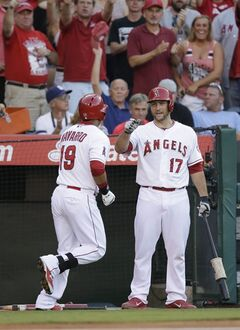 Los Angeles Angels' Efren Navarro, left, is congratulated by Chris Iannetta after hitting a home run during the second inning of a baseball game against the Detroit Tigers on Saturday, July 26, 2014, in Anaheim, Calif. (AP Photo/Jae C. Hong)