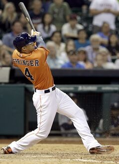 Houston Astros' George Springer hits an RBI single in the 11th inning of a baseball game to beat the Seattle Mariners 5-4 Friday, May 2, 2014, in Houston. (AP Photo/Pat Sullivan)