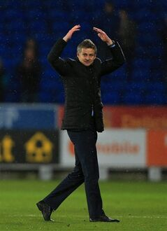 Cardiff City Manager Ole Gunnar Solskjaer celebrates his side's victory after their English Premier League soccer match against Norwich City at Cardiff City Stadium, Cardiff, Wales, Saturday, Feb. 1, 2014. (AP Photo/Nick Potts, PA Wire) UNITED KINGDOM OUT - NO SALES - NO ARCHIVES
