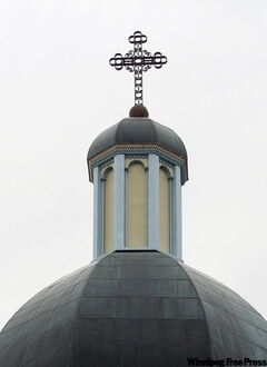 One way to easily distinguish the two types of churches is by their crosses. The Ukrainian Catholic cross atop its domes is just the regular pole stake and one cross piece.