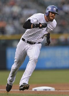 Colorado Rockies' Charlie Blackmon rounds third in route to score on a Troy Tulowitzki hit during the first inning of a baseball game against the New York Mets, Friday, May 2, 2014, in Denver. (AP Photo/Jack Dempsey)
