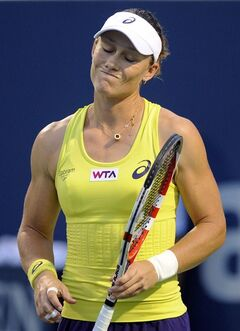 Samantha Stosur, of Australia, reacts during a semifinal against Petra Kvitova, of the Czech Republic, at the New Haven Open tennis tournament in New Haven, Conn., on Friday, Aug. 22, 2014. (AP Photo/Fred Beckham)