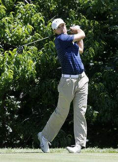 Jordan Spieth watches his tee shot during the Pro-Am round of the 2014 John Deere Classic golf tournament at TPC Deere Run in Silvis, Ill., Wednesday, July 9, 2014. (AP Photo/Charles Rex Arbogast)