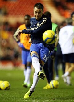 Chlesea's captain John Terry controls the ball ahead of their English FA Cup fifth round soccer match against Middlesbrough at the Riverside Stadium, Middlesbrough, England, Wednesday, Feb. 27, 2013. (AP Photo/Scott Heppell)