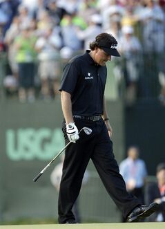 ADVANCE FOR WEEKEND EDITIONS, JUNE 7-8 - FILE - In this Jun 16, 2013, file photo, Phil Mickelson reacts after missing a shot on the 18th hole during the fourth round of the U.S. Open golf tournament at Merion Golf Club in Ardmore, Pa. No one has ever had so many chance in one major without ever winning it. Somehow, Mickelson is as optimistic as ever. (AP Photo/Julio Cortez, File)