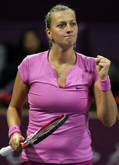 Petra Kvitova of the Czech Republic raises a fist after winning a point during a match against her compatriot Lucie Safarova during the fourth day of the WTA Qatar Ladies Open in Doha, Qatar, Thursday, Feb. 13, 2014. (AP Photo/Osama Faisal)
