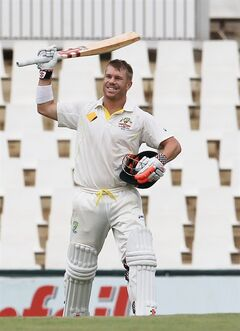 Australia's batsman David Warner, raises his bat after reaching a century on the third day of their cricket test match against South Africa at Centurion Park in Pretoria, South Africa, Friday, Feb. 14, 2014. (AP Photo/ Themba Hadebe)