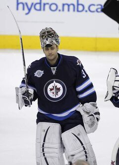 Ondrej Pavelec salutes the crowd following the team's final game of the season against the Tampa Bay Lightning, Saturday, April 7, 2012.