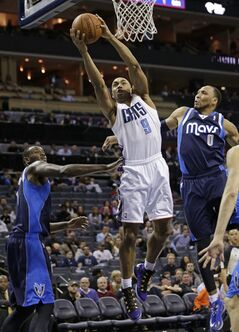 Charlotte Bobcats' Gerald Henderson (9) drives between Dallas Mavericks' Samuel Dalembert, left, and Shawn Marion, right, during the first half of an NBA basketball game in Charlotte, N.C., Tuesday, Feb. 11, 2014. (AP Photo/Chuck Burton)