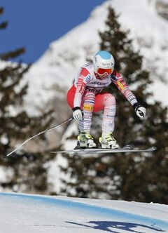 Julia Mancuso of the United States speeds down the course during an alpine ski, women's World Cup downhill, in Cortina D'Ampezzo, Italy, Saturday, Jan. 25, 2014. Mancuso placed 7th. (AP Photo/Marco Trovati)