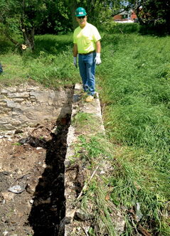 Richard Bean surveys the limestone foundation of the old Donald Murray house, which he says has been resilient in withstanding more than 150 years of being in the ground.