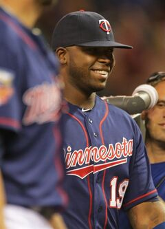 Minnesota Twins' Kennys Vargas smiles as he the team celebrates a 3-1 win over the San Diego Padres in a baseball game, Tuesday, Aug. 5, 2014, in Minneapolis. Vargas hit a three-run home run in the sixth inning. (AP Photo/Jim Mone)