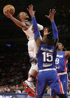 Dominican Republic center Jack Michael Martinez (15) and forward Edward Santana (8) defend U.S. guard Damian Lillard during the first half of an exhibition basketball game at Madison Square Garden in New York, Wednesday, Aug. 20, 2014. (AP Photo/Kathy Willens)