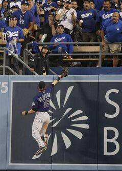 Colorado Rockies right fielder Charlie Blackmon can't catch a two-run home run hit by Los Angeles Dodgers' Hanley Ramirez during the third inning of a baseball game on Tuesday, June 17, 2014, in Los Angeles. (AP Photo/Jae C. Hong)