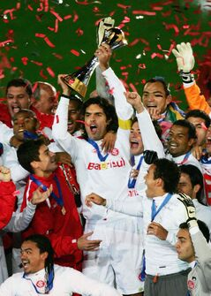 In this Dec.17, 2006 file photo, Brazil's SC International captain Fernandao, holding the Cup, celebrates with his teammates after winning the final against FC Barcelona in the final match in the FIFA Club World Cup in Yokohama, near Tokyo.