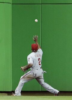 Philadelphia Phillies center fielder Ben Revere fields a ball hit by Miami Marlins' Jeff Baker for a double during the eighth inning of a baseball game on Wednesday, July 2, 2014, in Miami. The Marlins defeated the Phillies 5-0. (AP Photo/Wilfredo Lee)