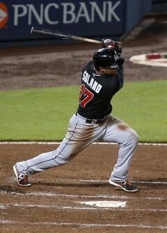 Miami Marlins' Donovan Solano (17) hits a single scoring Miami Marlins' Christian Yelich (not pictured) in the fifth inning of a baseball game against the Atlanta Braves, Saturday, Aug. 30, 2014, in Atlanta. (AP Photo/Jason Getz)