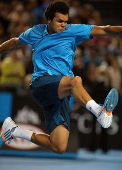 Jo-Wilfried Tsonga celebrates after defeating compatriot Gilles Simon of France in their third round match at the Australian Open tennis championship in Melbourne, Australia, Saturday, Jan. 18, 2014.(AP Photo/Rick Rycroft)