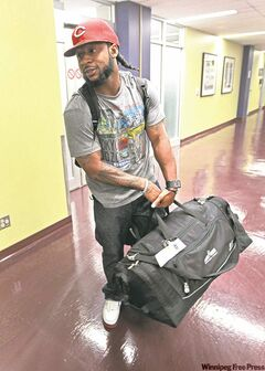 Jonathan Hefney hauls his luggage upon arrival at Richardson International Airport Tuesday afternoon.