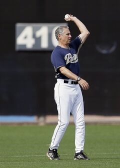 San Diego Padres manager Bud Black tosses the ball in from the outfield during a batting session at a spring training baseball practice Sunday, Feb. 16, 2014, in Peoria, Ariz. (AP Photo/Tony Gutierrez)