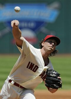 Cleveland Indians starting pitcher Josh Tomlin delivers against the Detroit Tigers in the first inning of a baseball game Sunday, June 22, 2014, in Cleveland. (AP Photo/Mark Duncan)