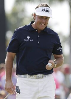 Phil Mickelson smiles after making par on the ninth hole during the third round of the Cadillac Championship golf tournament Saturday, March 9, 2013, in Doral, Fla. (AP Photo/Alan Diaz)