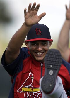 St. Louis Cardinals' Jon Jay stretches during spring training baseball practice Tuesday, Feb. 18, 2014, in Jupiter, Fla. (AP Photo/Jeff Roberson)