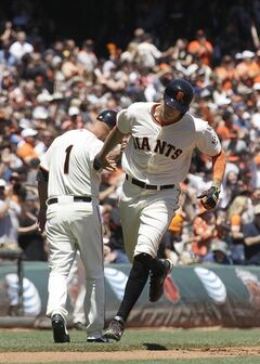 San Francisco Giants' Hunter Pence rounds the bases past third base coach Tim Flannery (1) after hitting a solo home run off of Minnesota Twins pitcher Ricky Nolasco during the third inning of a baseball game in San Francisco, Sunday, May 25, 2014. (AP Photo/Jeff Chiu)