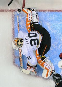 Anaheim Ducks goalie Viktor Fasth blocks a shot against the Los Angeles Kings during the first period of an NHL hockey game in Los Angeles, Monday, Feb. 25, 2013. (AP Photo/Chris Carlson)