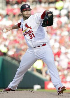 St. Louis Cardinals starting pitcher Lance Lynn sets to throw in the first inning of a baseball game against the Miami Marlins, Friday, July 4, 2014, in St. Louis.(AP Photo/Tom Gannam)