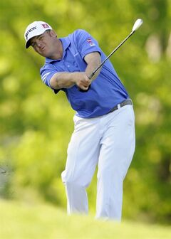 J.B. Holmes hits his approach shot on the 16th hole during the third round of the Wells Fargo Championship golf tournament in Charlotte, N.C., Saturday, May 3, 2014. (AP Photo/Mike McCarn)
