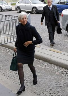 FILE - In this March 19, 2014 file photo, International Monetary Fund chief Christine Lagarde arrives at a courthouse, in Paris, Wednesday, March 19, 2014. Lagarde says she is under official investigation for negligence in a French corruption probe that dates back to her days as finance minister. In a statement released Wednesday, Aug.27, 2014 after a fourth round of questioning before magistrates, Lagarde said she was returning to her work in Washington later in the day and said the decision was