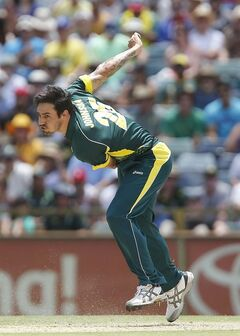 Australia's Mitchell Johnson bowls a delivery against England during their one day international cricket match in Perth, Australia, Friday, Jan. 24, 2014. (AP Photo/Theron Kirkman)